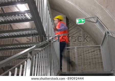 A motion blur abstract of a person walking ok the fire escape