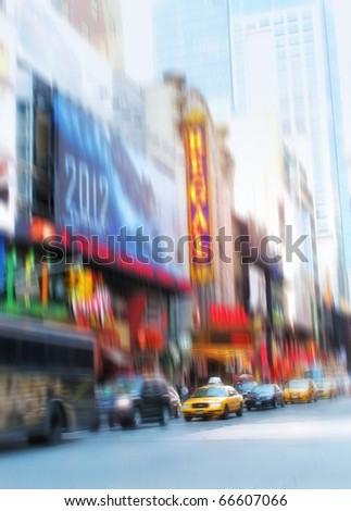 A motion blurred image of people  a Manhattan evening