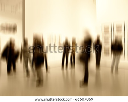 A motion blurred image of people at an exhibition