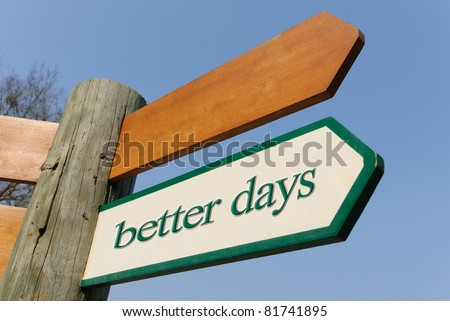 A motivational green and white wooden signpost pointing towards better days on sunny blue sky