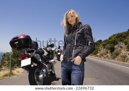 A motorcycle portrait of a beautiful young woman.