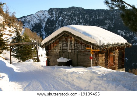A mountain hut covered by snow in Wallis, Switzerland - stock photo