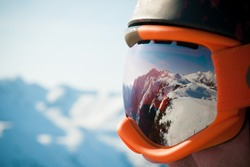 A mountain range reflected in the ski mask