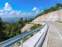 A mountain road with a terrific view. Route 4018 in northern Thailand offers a thrilling motorbike ride plus fantastic vistas across the rural Thoeng valley of Chiang Rai.