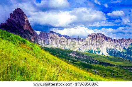 A mountain slope in the middle of a wide valley. Mountain valley landscape. Valley in mountains. Mountain landscape