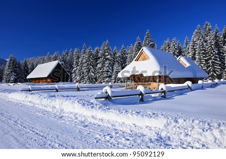 A mountain wooden huts covered with fresh snow  in Chocholowska valley - Tatra Mountains