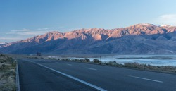 A mountains landscape, a highway and a salt lake, the California.