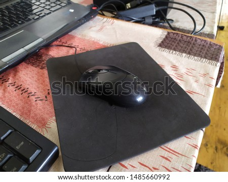 A mouse on the mouse pad #1485660992