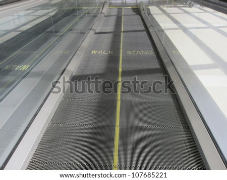 A moving walkway at a modern airport