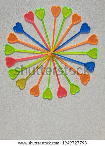A multi-colored circle of canapé skewers, in the form of a heart, symbolizing the sun on a white background. Concept. Photo stock ©