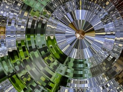 A multi green coloured reflective and shiny abstract concentric circle decorative design image