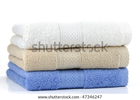 A multicolored towels stacked up - stock photo