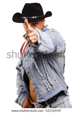 A muscular man in a cowboy hat shooting from a finger. Isolated on white.