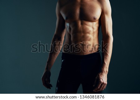 A muscular man taurus muscular naked torso workout fitness dark isolated background
