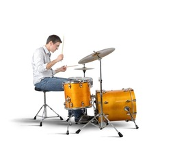 A musician plays his drums with passion