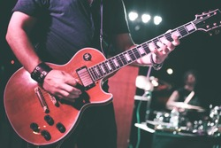 A musician plays the electric guitar during a live concert