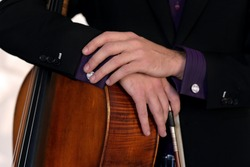 a musician with a bow and cello. classical cellist