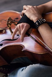 a musician with a bow and cello. rock cellist