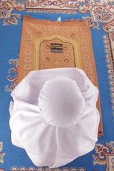 a Muslim mother is saying a prayer. white background