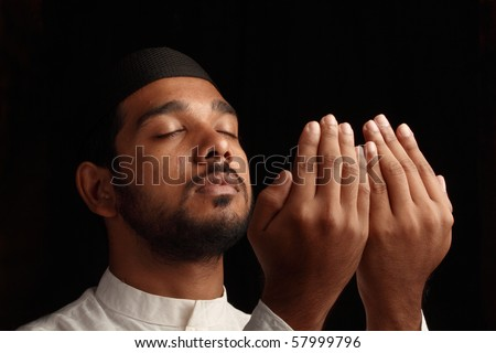 A Muslim praying in darkness - Side view