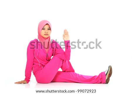A muslim woman stretching her leg before jogging isolated on white
