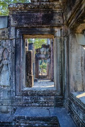 A mysterious, secret passageway with multiple stone door frames in the famous Angkor Thom (Bayon Temple), a UNESCO World Heritage Site in Siem Reap, Cambodia.