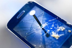 A nail in an old phone, it's punched. In the background a new phone.