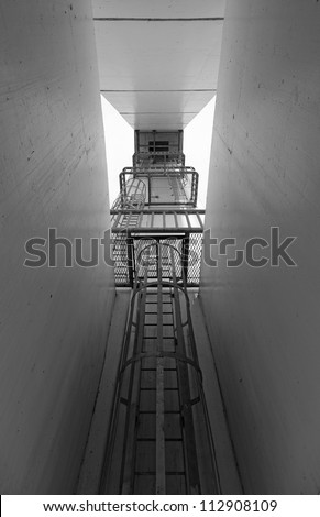 A narrow escape stairwell shaft.