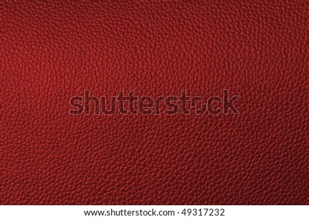 a natural red leather texture. close up.