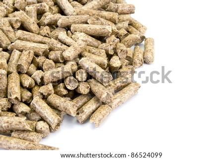 A neat pile of wood pellets, isolated on white. Fragment.