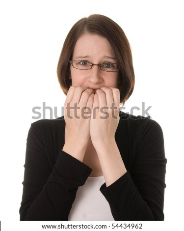 A nervous woman looks at the camera biting her fingernails