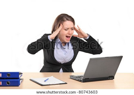 A nervous young businesswoman yelling isolated against white background - stock photo