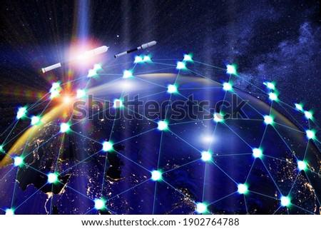 A network of linked satellites orbiting the earth. Global satellite internet service concept.3d illustration