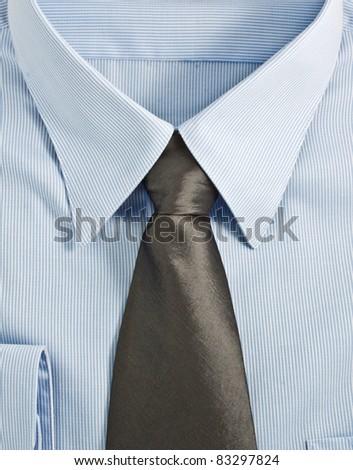 A new blue shirt with necktie, studio shot