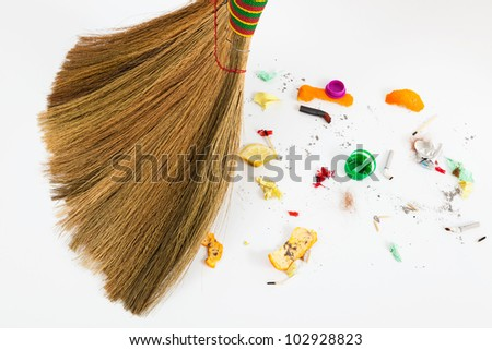 a new broom sweeping various debris and mud
