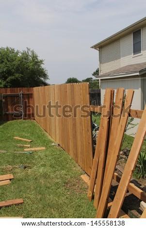 A new cedar fence under construction