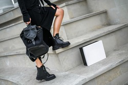 a new collection of women's shoes autumn winter '20 / 21. The girl bought new shoes. Legs in boots. Boots in a box