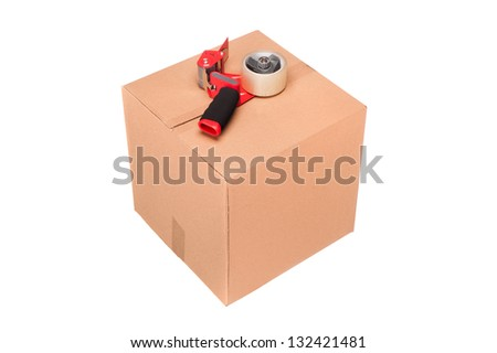 A new corrugated cardboard shipping box with tape dispenser isolated on white