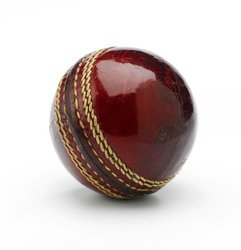 A new cricket ball on a white background showing stiching.