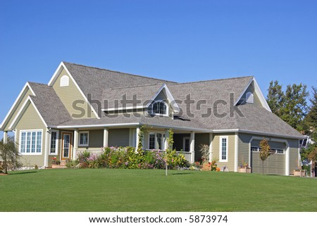A new executive home with landscaped grounds.