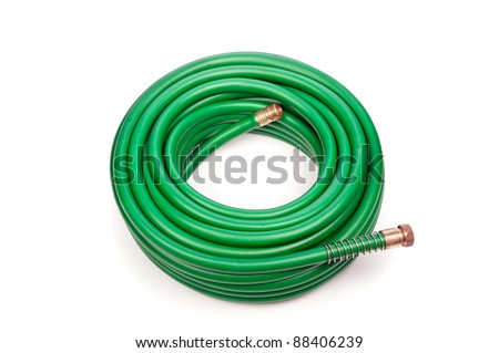 A new green coiled rubber hose on a white background.