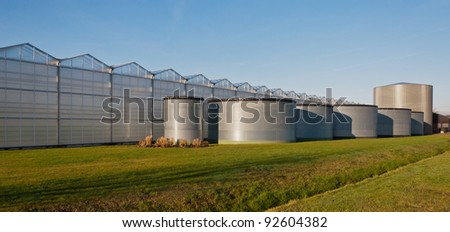 A new greenhouse complex in the Netherlands with a series of small and large liquid tanks above ground.