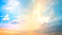 A new heaven and earth concept: Dramatic sun ray with blue orange color sky and clouds dawn texture background