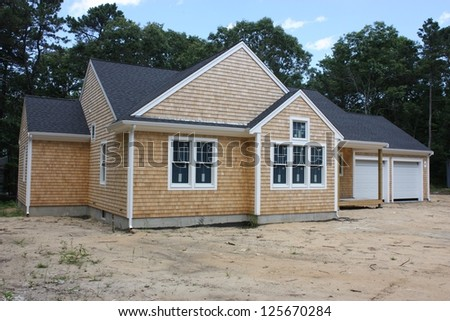 A new house and garage under construction in the suburbs