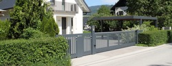 a new house with a metal sliding gate