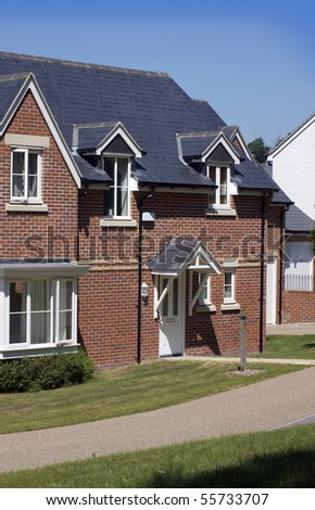 A new modern housing development. Recently built new houses constructed of red brick with grey slate roofing. location in Salisbury, Wiltshire.