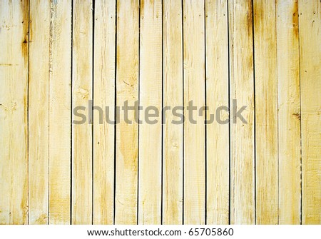 A new natural pine wood fence yellow / brown background