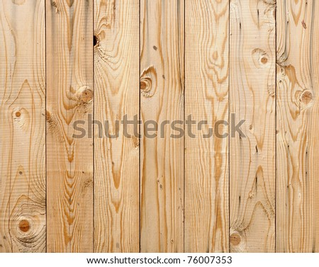 a new natural wood fence - stock photo