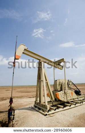 A new oil well or pumpjack with copy space
