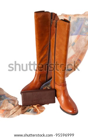 A new pair of boots, fashionable scarf and hand bag